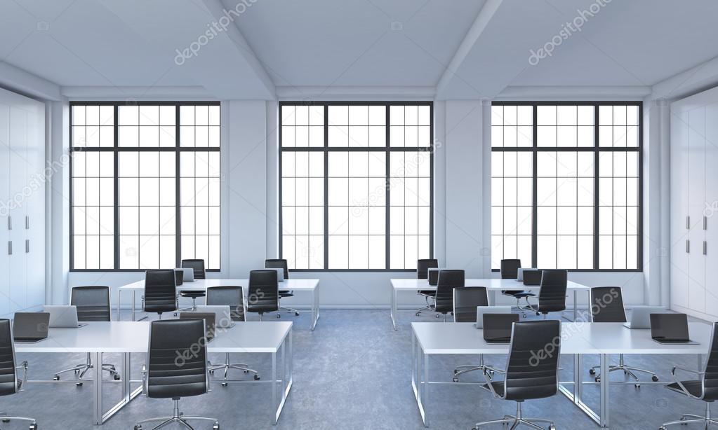 Luoghi di lavoro in un ufficio loft moderno luminoso open for Tavoli bianchi moderni