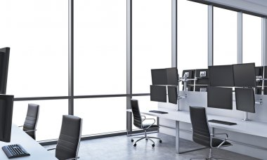 A modern trader's workplaces in a bright modern open space office. White tables equipped with modern trader's stations and black chairs. White copy space in the panoramic windows. 3D rendering.