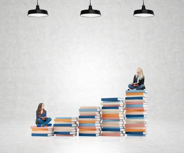 two young women sitting books thinking about future, dreaming
