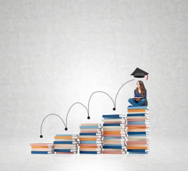 young woman sitting books thinking about future, dreaming