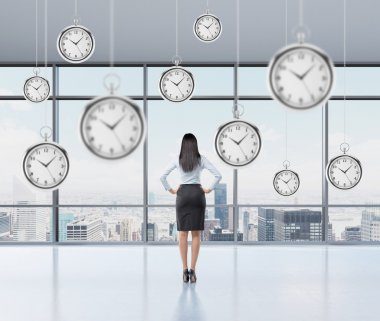 businesswoman thinking about time, pocket watch hovering above