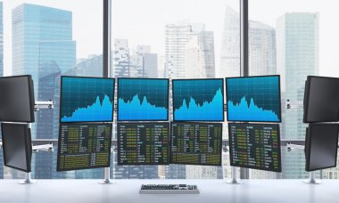 office with switched on monitors, processing data for trading,