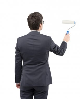 Businessman painting on a white wall