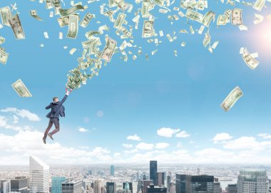 A young businessman flying over Paris with a magnet in hand that is pulled to money tornado.