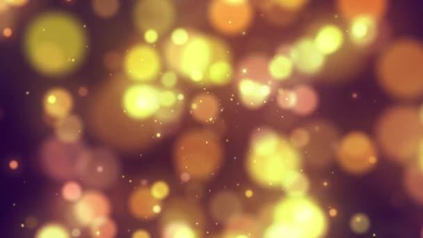 Pozadí se zářícími zlatými pohyblivými částicemi a kruhy na tmavém pozadí.