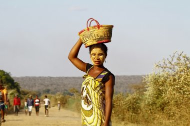 Portrait of malagasy woman with tradytional mask on the face, Ma