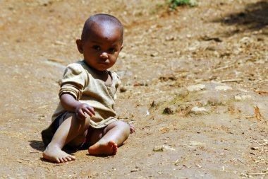 Poor african kid on ground, Madagascar
