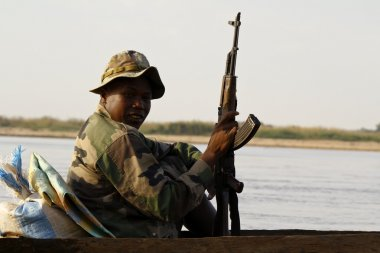 African soldier during operation - transported by traditional ca