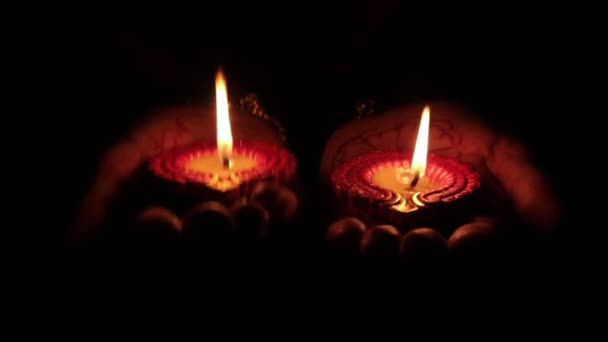 Deepak candle in the hands of Indian women
