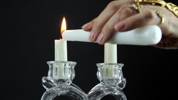 Indian woman lighting candles