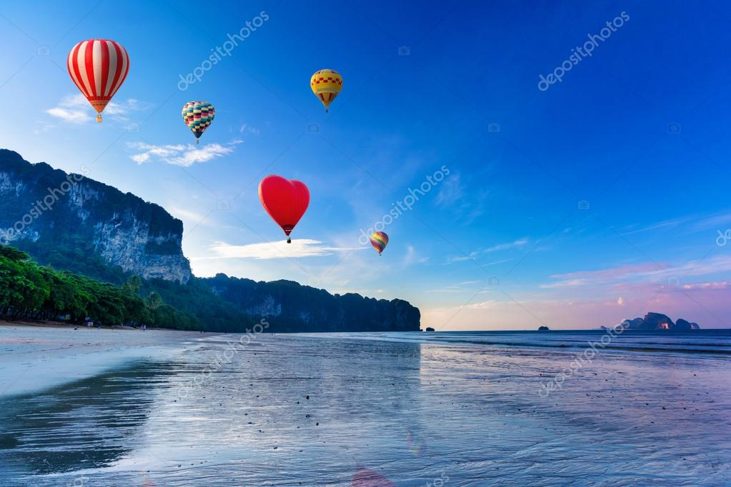 Hot-air balloons flying over sunset