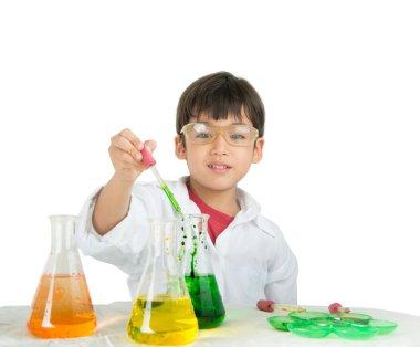 Little boy learning in chemecal in science in class
