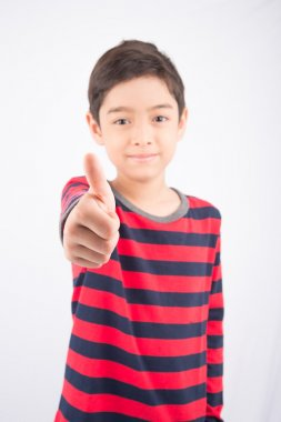 Little boy showing his thump up on white background