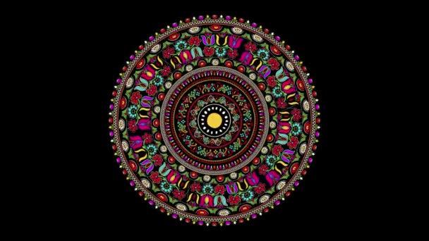 Dekoratív forgó ikon hagyományos magyar hímző szimbólumokkal. Zökkenőmentes hurok felett fekete háttér.