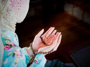 Young muslim woman praying for Allah, muslim God stock vector