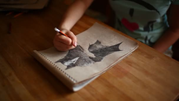 girl artist hands drawing with a pencil