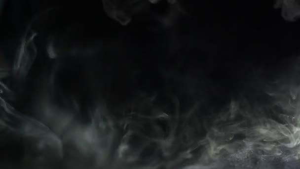 fast moving smoke on black