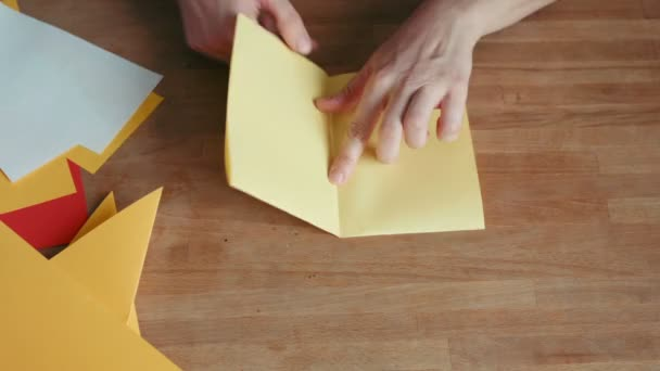 hands making origami ship
