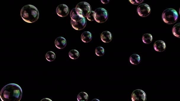mýdlové bubliny izolované na černém pozadí