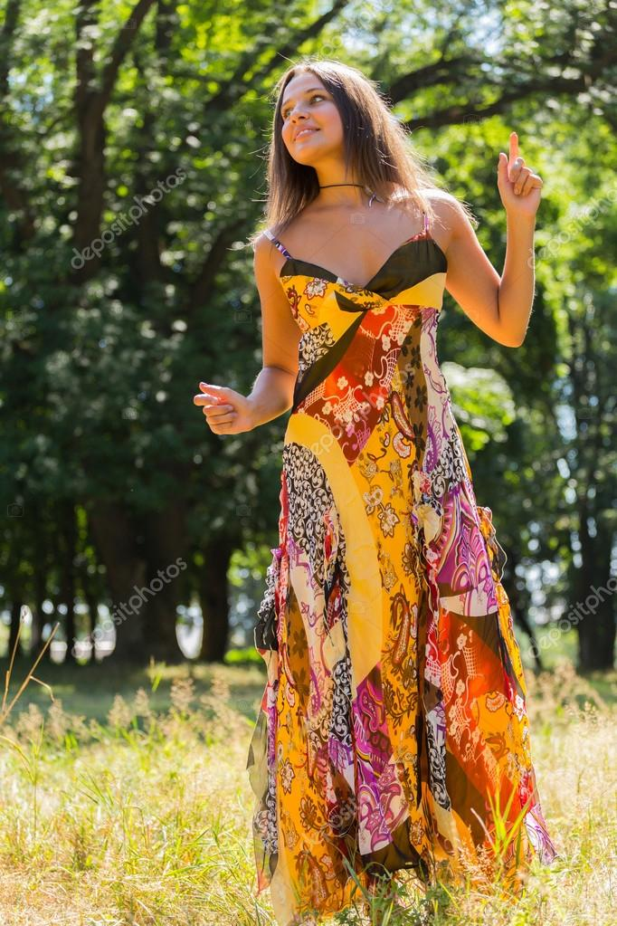 A Young And Attractive Girl In Beautiful Summer Dress Middle Of