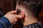 Fotografie Haircut men Barbershop. Mens Hairdressers; barbers. Barber cuts the client machine for haircuts.