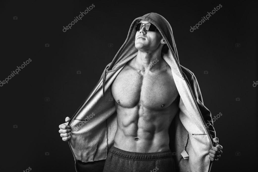 Man Shows Muscular Chest And Abs Stock Photo Aallm 60982095