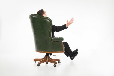 Male businessman sitting on leather chair