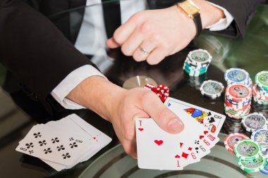 Poker cards in hand and chips