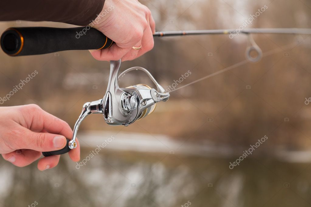 Fisherman holding a light spinning rod