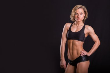Athletic girl on a black