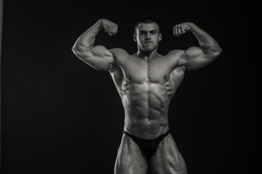 Bodybuilder shows his muscles