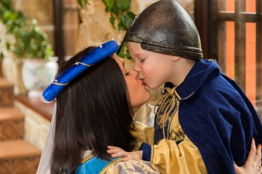 Mother and son in medieval costumes