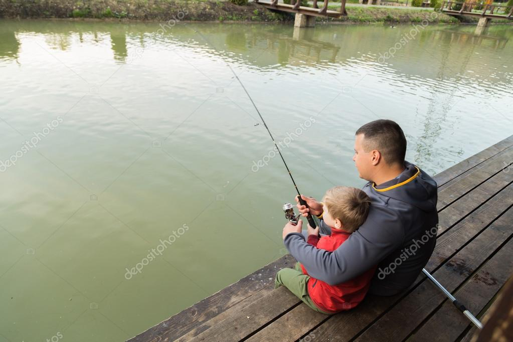 Father and son in the process of catching fish