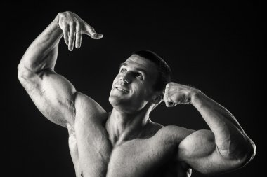 man shows muscles