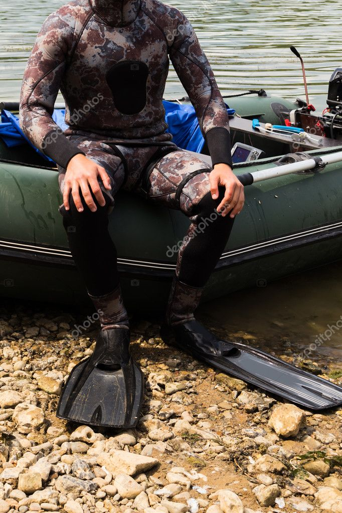 A man in a wet suit on the river
