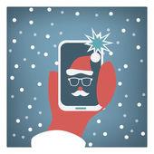 Fotografie Santa claus taking selfie funny christmas card design.