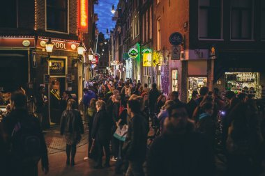 People on the street at night