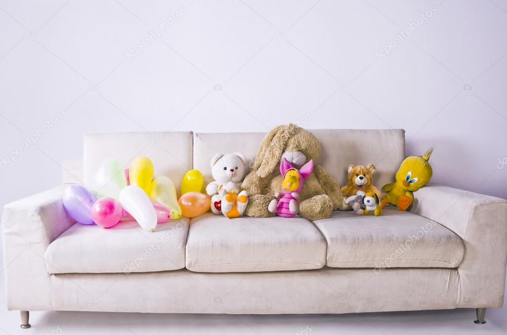 Soft Toys And Balloons On The Couch Stock Photo C Imagedb Seller