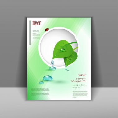 booklet with green leaves and drops of pure water