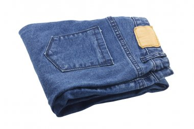folded blue jeans with leather label