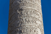 Close-up of the Trajan Column, Roman triumphal monument built by Emperor Trajan to celebrate the victory in Dacia Wars.