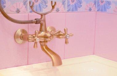 bathtub faucet under bronze