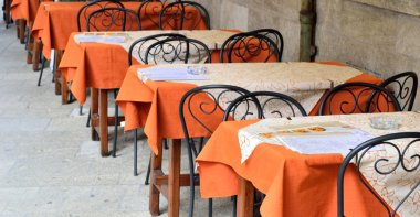 street cafes without visitors unoccupied tables and chairs