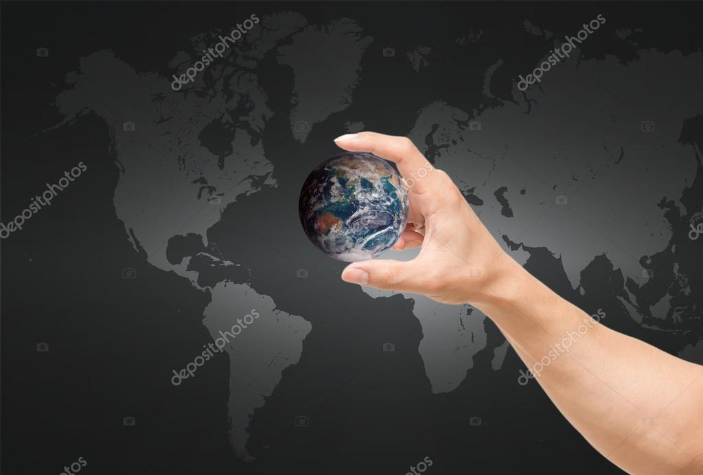 Man hand catching the earth on world mapelements of this image man hand catching the earth on world mapelements of this image furnished by nasa gumiabroncs Images