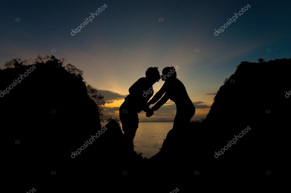 Silhouettes of happy lovers