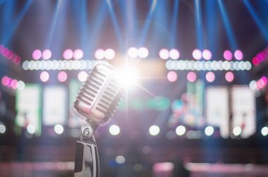 Retro microphone over the Stage Spotlight with blue luminous rays and Blurred Photo bokeh from light,musical concert and instrument concept stock vector