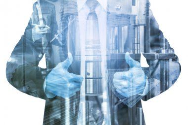 Double exposure of businessman with Industrial equipment