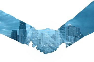 double exposure handshake between businessman on a city backgrou