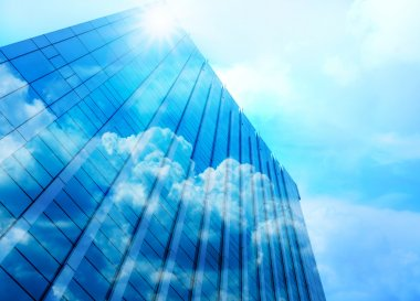 Closeup  building glass of skyscrapers with cloud, Business concept of architecture