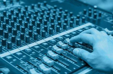 Hand adjusting audio mixer stock vector
